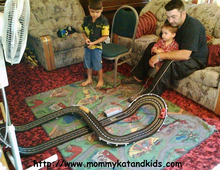 Curtis, Zack and Ben Lavallee playing with slot cars