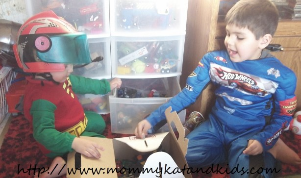 boys in costumes playing cars