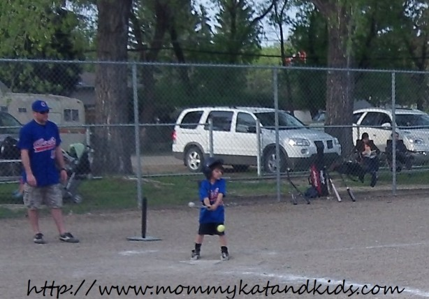 boy hitting a baseball