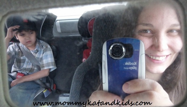 reflection of family in vehicle