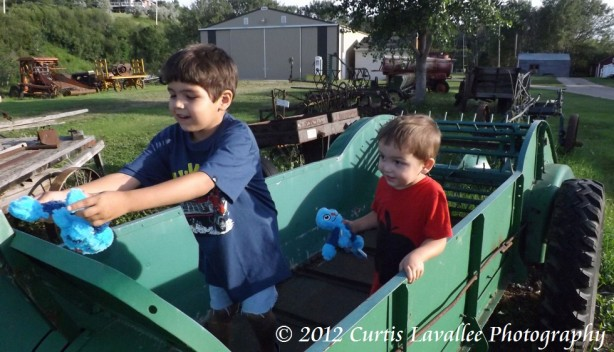 boys in farm machinery