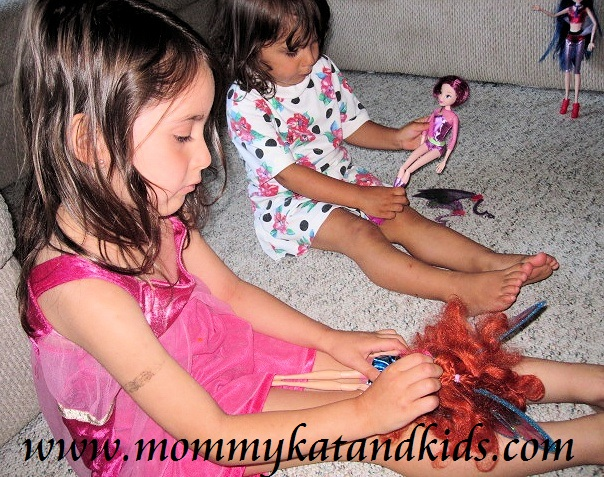 girls playing with winx club dolls