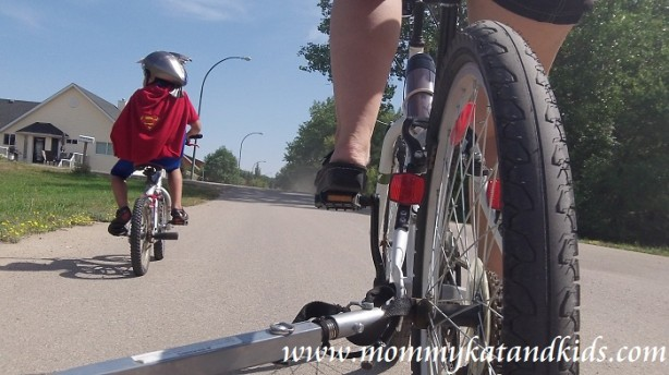 mom and boy on bike