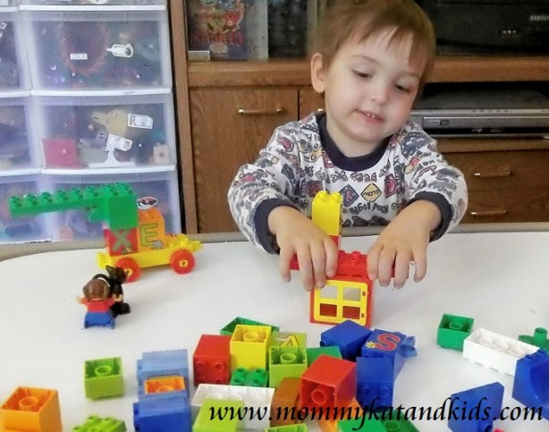 boy playing with lego duplo