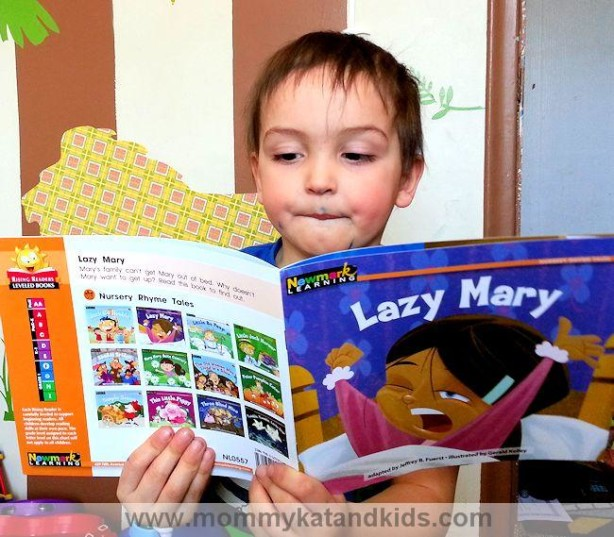 boy reading newmark learning book