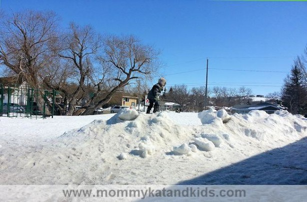 boy playing in snow saskatchewan