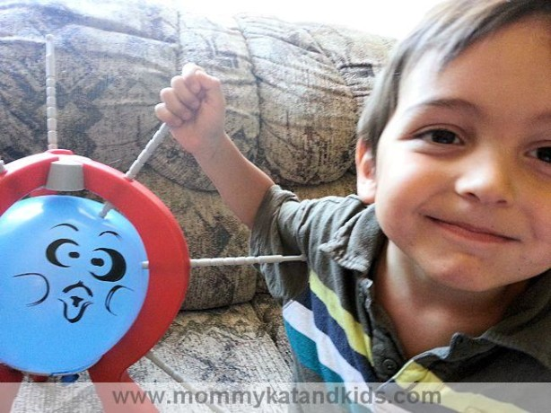 boy playing boom boom balloon spin master