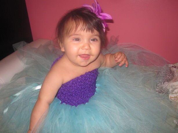 happy baby in tutu dress