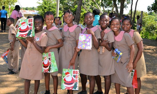 sandals foundation girls with presents