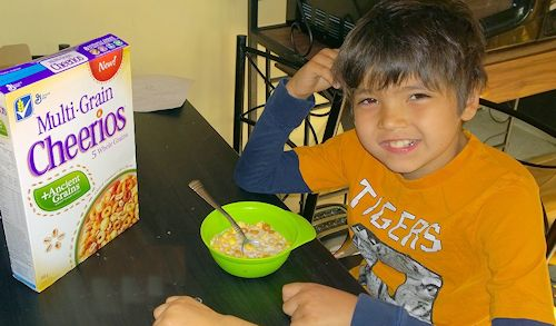 boy eating multi-grain cheerios ancient grains