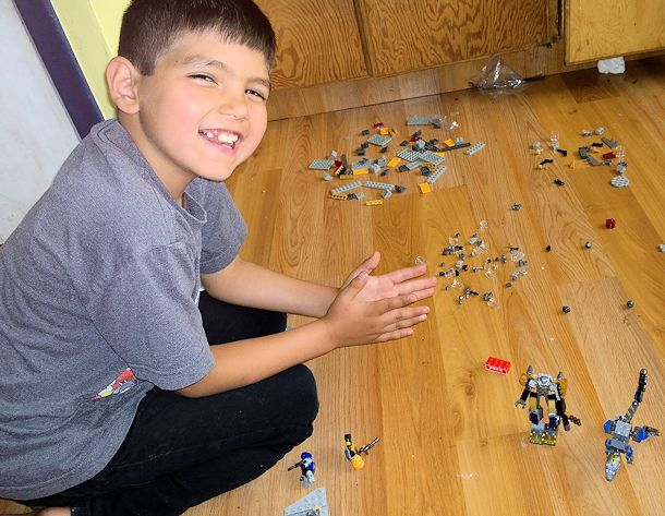 boy building kre-o transformers set