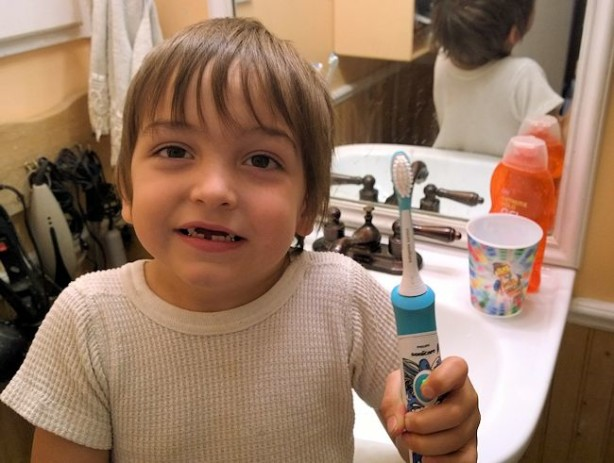 benjamin with sonicare for kids brush