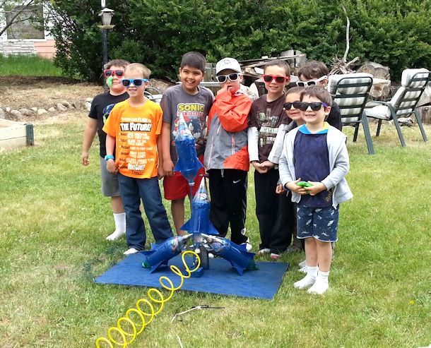 boys at water bottle rocket launch pad