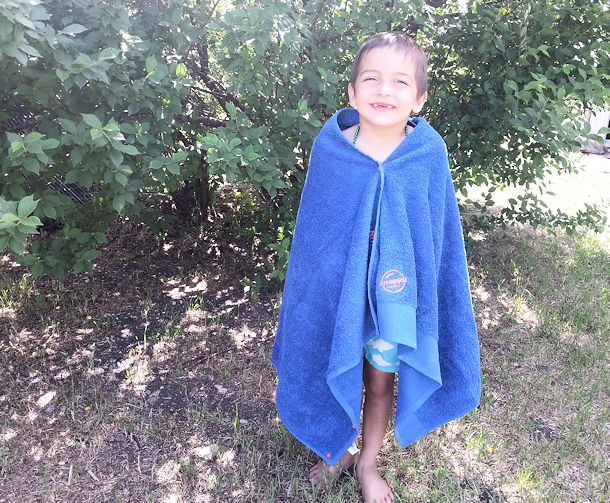 boy in snappy towel coverup