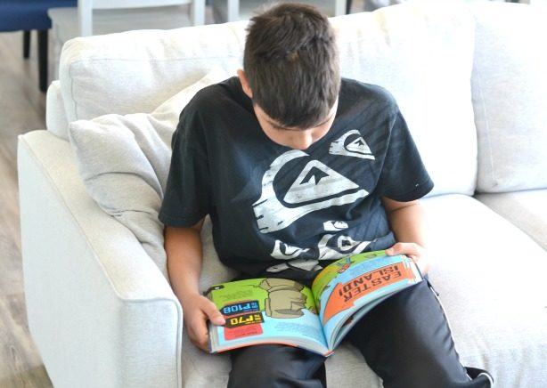 boy-reading-kids-travel-books