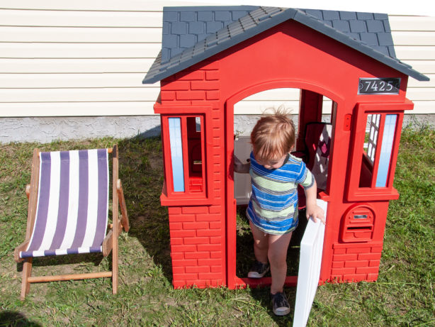 boy-in-little-tikes-playhouse