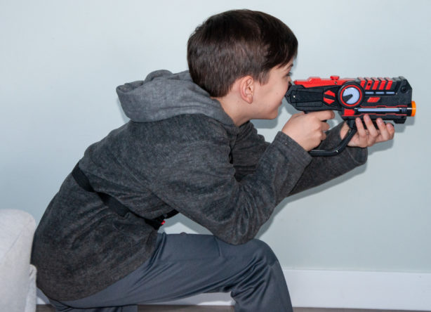 boy-playing-laser-tag-at-home