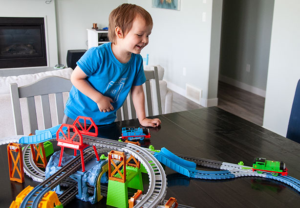boy-playing-with-train-set